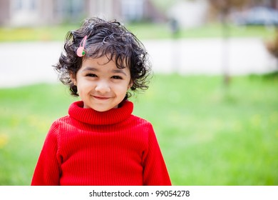 Portrait of a Smiling Toddler Girl in Spring