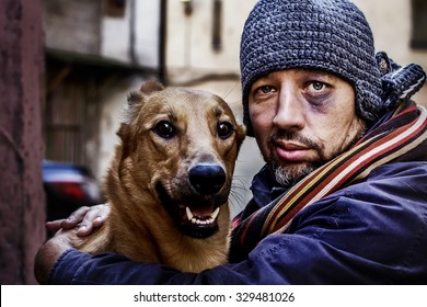 Portrait of smiling tramp and his dog. Image with toning and selective focus