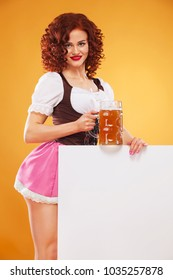 Portrait of smiling waitress standing with beer mog and white banner for copy space