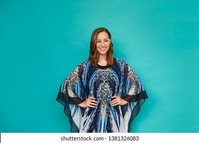 Portrait of smiling woman in blue kaftan