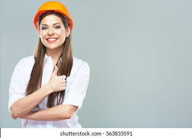 Portrait of smiling woman estate adviser show thumb up on isolated background.