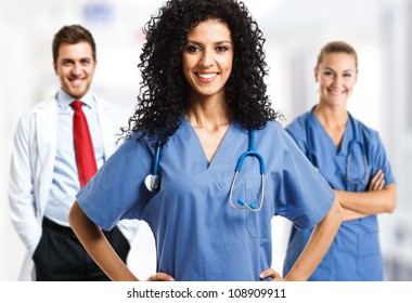 Portrait of a smiling woman in front of her medical team