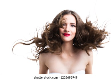 Portrait of a smiling woman with hair in the wind. Isolated.