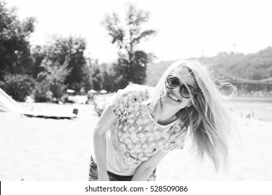 portrait of a smiling woman, happy girl in nature, positive walk on the beach with a sun girl. Film Texture & Unfocused