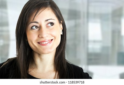 Portrait of a smiling woman looking up