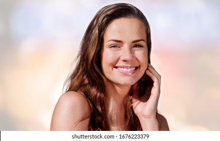 Portrait of smiling woman with perfect skin