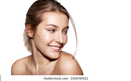 Portrait of smiling  woman posing with bare shoulders. Cute girl with clean and fresh skin. Skincare wellness and spa concept. Isolated on white copy space in right side