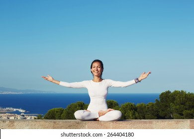 Portrait of smiling woman practicing yoga by raising her hands feeling so good and happy, young woman seeking enlightenment through meditation, relaxed girl performing and enjoy yoga routine, filter
