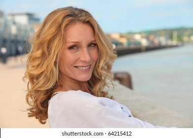 Portrait of a smiling woman at the sea