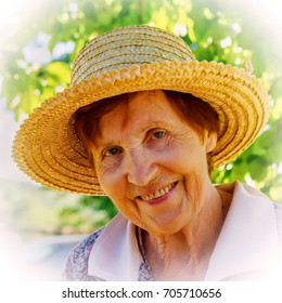 Portrait of a Smiling Woman in a Straw Hat. Age Eighty Years. Old Woman.