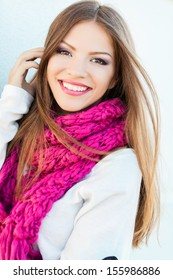 Portrait of smiling woman wearing woolen accessories