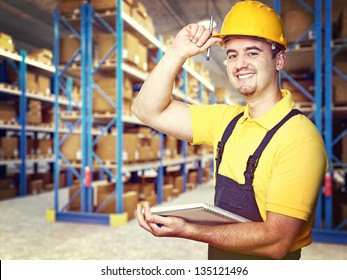 portrait of smiling worker in warehouse