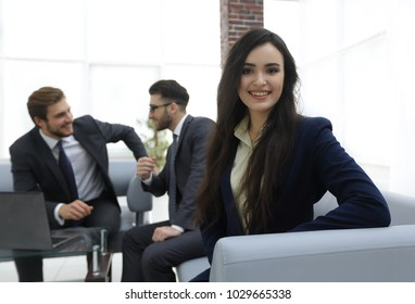 Portrait of smiling working girl in meeting.