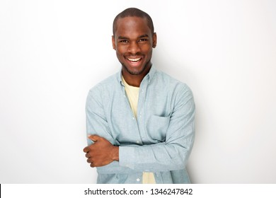 Portrait of smiling young african american man smiling with shirt by white background