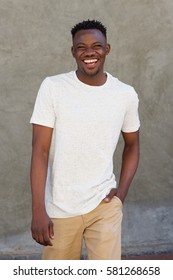 Portrait of smiling young african american guy walking outside