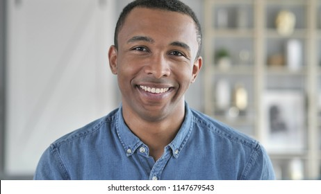 Portrait of Smiling Young African Man Looking at Camera