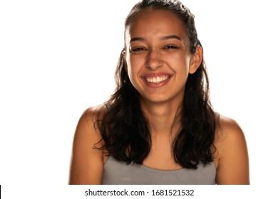 portrait of smiling young arabic woman on white background