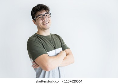 Portrait of smiling young Asian man wearing eyeglasses standing with folded arms and looking at camera. Intelligence concept