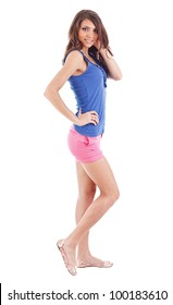 Portrait of smiling young beautiful woman in shorts at full heigh