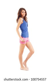 Portrait of smiling young beautiful woman in shorts at full heigh, isolated in white