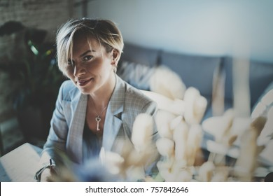 Portrait of smiling young beautiful woman at livingroom. pretty girl smile while looking at the camera. Blurred background