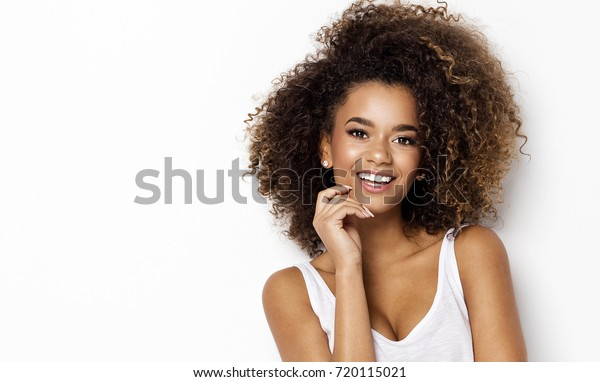 Portrait of smiling young black woman with copy space
