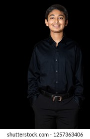 Portrait of a Smiling Young Boy, Isolated, Black