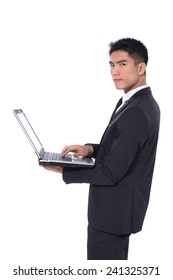 Portrait of a smiling young businessman with laptop