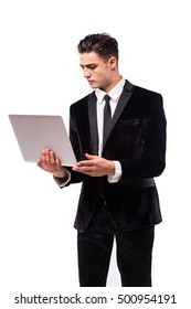 Portrait of smiling young businessman with laptop isolated over white background.