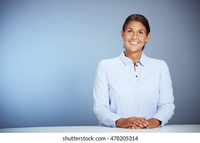 Portrait Of A Smiling Young Businesswoman Looking Straight Into Camera