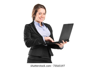 Portrait of a smiling young businesswoman working on a laptop isolated on white