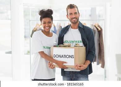 Portrait of a smiling young couple with clothes donation