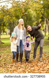 Portrait of a smiling young family on an autumns day