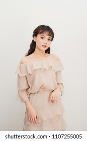 Portrait of smiling young fashionable asian woman