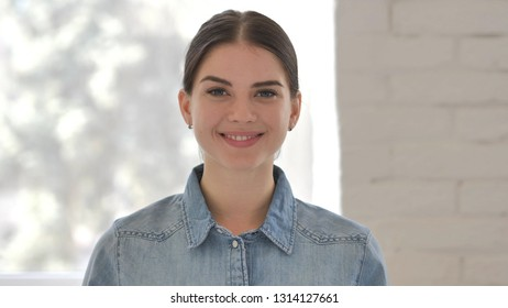 Portrait of Smiling Young Girl Looking at Camera