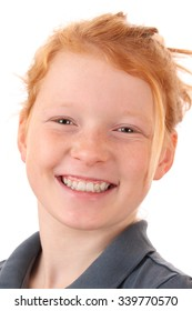 Portrait of a smiling young girl on white background