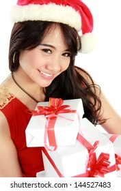 portrait of smiling young girl wear a hat santa bring some gift