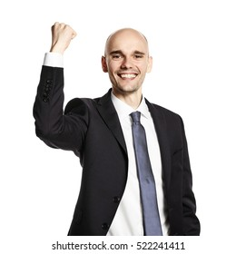 Portrait of smiling young man celebrating his success. Studio shot isolated on white.