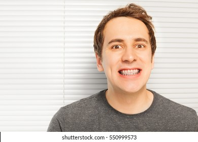 Portrait of smiling young man with dental braces