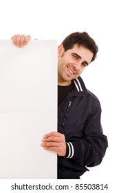 Portrait of a smiling young man holding blank billboard