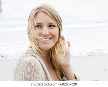 Portrait of a smiling young woman on a beach