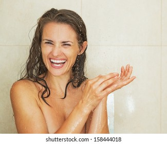 Portrait of smiling young woman taking shower