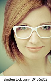 portrait of smiling young woman in white sunglasses