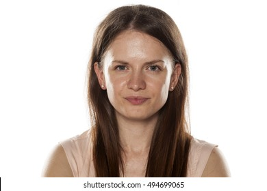 Portrait of a smiling young woman without makeup