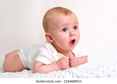 Portrait of a smilling baby isolated on a white background