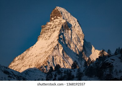 Portrait of the Snow capped peak of the famous Matterhorn of the Swiss Alps at sunrise