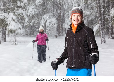 Portrait of Snowshoer (With Second Snowshoer in the Background)