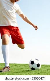 Portrait of a soccer player with ball on football field