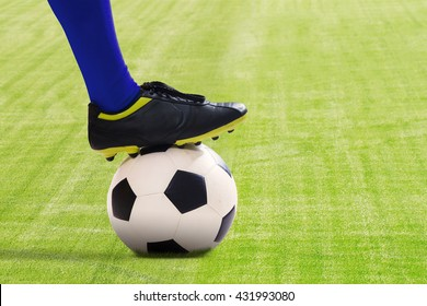 Portrait of soccer player ready to kick the ball at field
