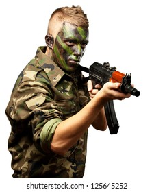 Portrait Of A Soldier Aiming With Gun On White Background